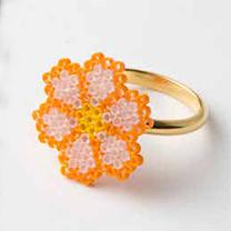 フラワーモチーフのリング(オレンジ)